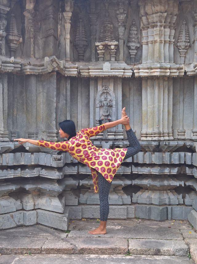 Ernestine practicing dancer pose in a temple in mysore